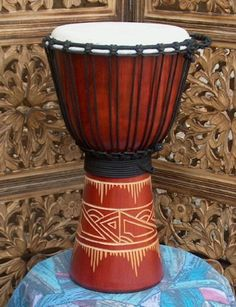 """Line-Carved Djembe Drum- 19""""-20"""" Tall x 9-10"""" Head by Mother Rhythm Drums. $69.00. Nice, affordable djembe drum in an antique red appearance and a simple line-carving on the stem. Great for the beginner and experienced player alike. Made of environmentally friendly one-piece mahogany wood and premium goat skin at the head."""