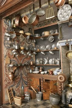 another view ...Dutch cabinet kitchen, 1670-1700. In Holland, well-to-do Dutch families preferred to store their treasures in cupboards and cabinets of the sort that were used to store linen or china. The wealthy classes liked to demonstrate evidence of their wealth by collecting precious or interesting and new items in curiosity cabinets. Amongst these were miniatures of household items specially commissioned and collected with such enthusiasm that whole households were sometimes…