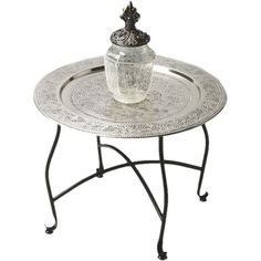 An artful canvas for a vase of bright blooms or your favorite family photos, this chic aluminum side table showcases an ornately embossed tray top and a slen...