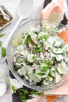 Greek yogurt spiked with garlic, dill, lemon and mint dresses crunchy cucumbers for a favorite, refreshing and creamy summer salad that's unbelievably easy.