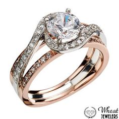 Two Tone Criss Cross Round Halo Engagement Ring with Diamond Accents #engagementring #halo