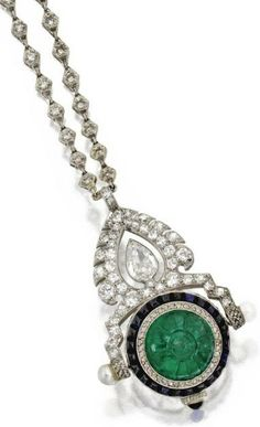 Emerald, sapphire, diamond and pearl pendant-watch, Circa 1930. Pear-shaped, old European-cut, rose-cut and single-cut diamonds weighing approximately 4.70 carats, additionally set with a carved emerald, cabochon sapphires and pearl terminals.