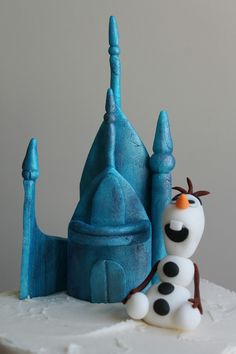 Birthday Cakes - The castle is made from fondant and painted with edible pearl dust mixed with lemon extract. Once dry, I assembled it together on the top of the cake