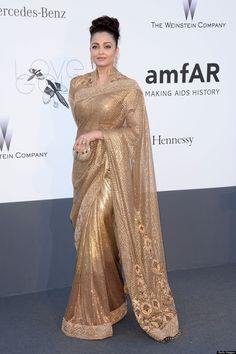 Aishwarya Rai looks graceful gorgeous in the gold Sari at Cannes 2013 Bollywood Designer Sarees, Bollywood Saree, Indian Bollywood, India Fashion, Asian Fashion, Indian Dresses, Indian Outfits, Golden Saree, Indie Mode