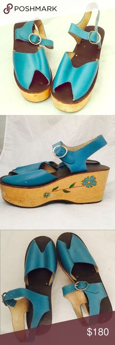 """Vintage 70s Platform Wedge Wood Sandals 8 Boho Adorable platform wedge peep toe sandals with a blue leather upper and footbed with a wooden wedge. The wood is blonde and they have painted and etched flower details. The outer sole is resin.  Material: leather upper, wood platform, resin outer sole Color/print: Blue Maker:  Origin: Era:  60's 70's Size: 8  Insole- 9.5"""" 3.5"""" width (at the widest part of the shoe) Heel- 3.5""""   Platform Toe-1.5""""  Condition: very good, showing minimal wear to the…"""