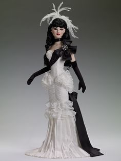 """#Pin2Win $224.99 Tonner American Models Moonlight Waltz - Outfit only  Fits 22"""" American Model™  Off white dress with a lace overlay and ruffle trim, and black sash and bow with rhinestones  Black gloves  Black ribbon choker  Off white feather hair decoration with a pearl brooch  Taffeta shoes to match  Nude pantyhose  Includes a long, black, wavy center part saran wig  LE 150"""