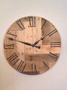 This decorative rustic wood clock has been made from reclaimed pallet boards. It has been arranged in a herringbone design and would make a