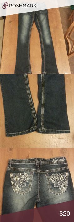 Hydraulic jeans Dark wash with white and silver stitching details.  Back pockets have stitching and rhinestones.  Beautiful condition!  Microboot style. Its more of a skinny jean look than boot cut. Hydraulic Jeans Boot Cut