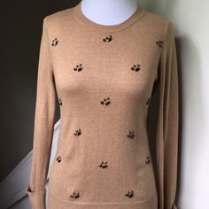 "LN Camel Embellished Sweater MERONA lightweight LIKENEW, NEVER WORN, washed once, never put in dryer.  Camel colored, jewel embellished lightweight sweater by MERONA (target) - crew neck- Small. Very cute & comfortable! Bust measures 17"" - shoulders (from top stitch to top stitch) 14.5"" - underarm sleeve length 18.25"".  Length  from back neckline to bottom hem line 23""; 53% cotton, 40% rayonne, 7% nylon. Last photo from web to show style…"