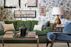 Here's a little secret: Dark green, like this sofa's forest hue, has a way of making blue and white feel more inviting. Its grounding effect on the airy combo begs you to sit down and stay awhile. For a cohesive look, pair deeper greens with blues of equal depth. Then add in large swaths of white, such as the lampshade and wallpaper background below, to counter the intense shades.