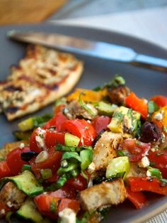Grilled panzanella: chop peppers, zucchini, crusty bread, grill till slightly charred. Add cucumber, tomato, olives, mint, basil; coat with olive, vinegar, and feta/mozzarella.