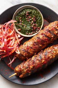 seekh kebabs are made with ground lamb that's been seasoned with garam masala, cumin seeds, fresh ginger and fresh cilantro, then grilled and served with raw red onion and bright mint chutney to offset the richness and heat. Seekh Kebab Recipes, Seekh Kebabs, Lamb Recipes, Chicken Recipes, Cooking Recipes, Healthy Recipes, Grill Recipes, Turkish Recipes, Indian Food Recipes