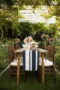 The inspiration for the shoot came from navy blue and white stripes with coral and gold accents.  Photography + Invitations: Jessica's Photography / Photo Shoot Venue: A Private Residence in Logan, Utah / Event Design: Jessica Smith Parker / Floral Design + Decor: Dahlia Event Planning / Cake: Graceful Baker / Parker + Susie Tibbetts / Table + Linens: Jessica Smith Parker / Chairs: Red Poppy Linens and Chairs (Formerly Marcie Taylor Events and Rentals) /   Style Me Pretty | Gallery
