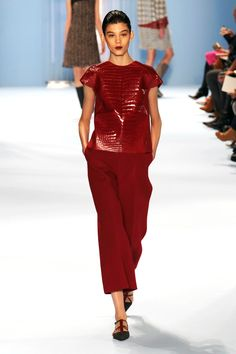 She can do minimal, too, just put through an uber luxurious sieve. How about a set of fire engine red exits that centered the collection. Who else but Herrera could do a t-shirt in glossy red croc? The loose, cropped trousers worn with flat shoes felt effortless and of-the-moment.    - HarpersBAZAAR.com