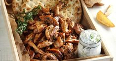 Aki's delicious gyro recipe. Pieces of juicy and tender chicken wrapped in pita bread and a savory tzatziki sauce!