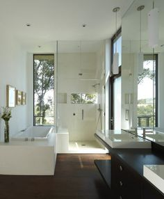 #6 | 2013 Houzz Bath  Open, modern California shower. This room's tall ceilings, natural light and contrasting dark hardwood floor caught Houzzers' eyes when they were browsing bathrooms this year. The clean lines of the shower and bath would work in any home.