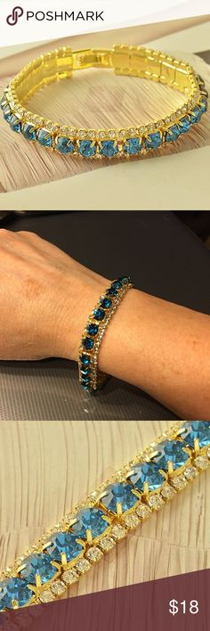 Dark Teal CZ & 9K Gold Filled Tennis Bracelet 3 row dark teal & clear CZ & 9K gold filled tennis bracelet. 7.5 inches in length. Boutique Jewelry Bracelets