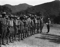 WWI, 1916, Salonika; British soldiers on parade waiting to receive their daily dose of the anti-malaria drug Quinine. ©IWM