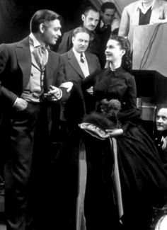 Vivien Leigh and Clark Gable on the set of 'Gone With The Wind' in the scene where the widowed Scarlett O'Hara Hamilton has just received her new green silk bonnet from Paris. Vivien Leigh worked for 125 days and received about $25,000. Clark Gable worked for 71 days and received over $120,000.