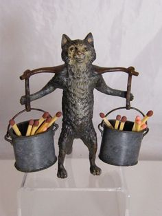 Image result for cast iron cat and cauldron match holder