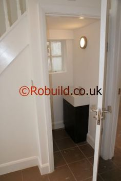 stairs design pictures with toilet underneath | cloakroom under the stairs