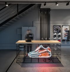 P-U-R-A designs hybrid sneaker showroom for footshop in prague P-U-R-A designs hybrid sneaker showroom for footshop in prague,Nike Retail design Achieve this same modern retail display with Abstracta Modular Displays system in matte. Boutique Interior, Clothing Store Interior, Clothing Store Design, Interior Design Awards, Showroom Design, Retail Interior, Shoe Store Design, Retail Store Design, Retail Stores