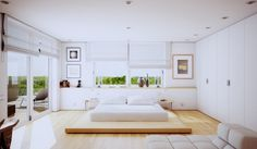 Beginning with a conservative decoration scheme, this airy white scene is perfect for those who like a clean and uncluttered lifestyle. The subtle run of built-in white closets go almost unnoticed despite their generous size, and the low platform bed creates a feeling of more space.