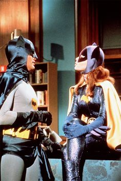 """T.A. says: Bat Girl responds, """"Beg me!"""" to Bat Man's suggestion of a nude dip in his hot tub."""