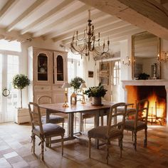 Stone floors, a roaring fire next to the dining room table and exposed beams. Yes, the French cottage charm comes alive with these grand, yet humble details. French Interior, French Decor, French Country Decorating, Interior Design, Rustic French, Modern Rustic, French Country Dining Room, French Country House, Country Chic