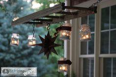 Pottery Barn inspired ladder lantern hanger using mason jars. Mason Jar Chandelier, Mason Jar Lighting, Outdoor Chandelier, Lantern Chandelier, Lantern Lighting, Jar Lamp, Mason Jar Crafts, Mason Jars, Unique Garden