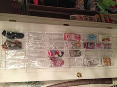 Nursery Organization - A simple over the door shoe rack. Used this in L's closet for her summer hats, shoes, and socks. So much easier than digging through bins!  -- Rach