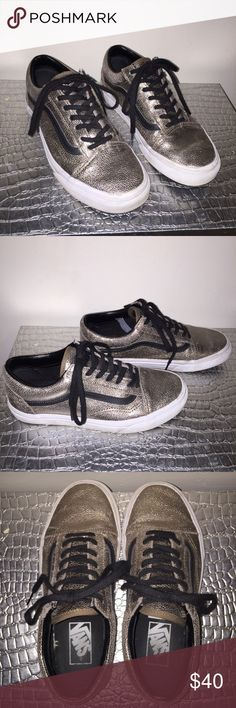 Metallic gold & black Old Skool Vans Old skool vans! Women's size 6.5, men's size 5. Gently worn but still in great condition!! Will clean off the white part as much as possible before shipping. Super shiny & cute, perfect for dressing up any outfit! Old skools retail for about $60 Vans Shoes Sneakers