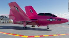 Navy fighter jet painted pink for breast cancer awareness month.