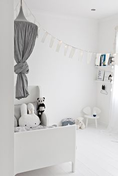 Love this simple and stylish grey and white room - perfect for boy or girl