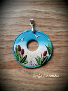 Check out this item in my Etsy shop https://www.etsy.com/listing/271009531/day-at-the-beach-round-polymer-clay