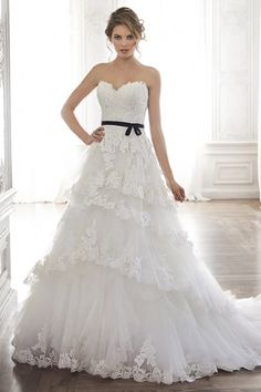Layers of tulle and lace: http://www.stylemepretty.com/lookbook/designer/maggie-sottero/ #SMPLookBook