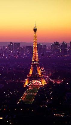 Eiffel Tower And Paris City Lights