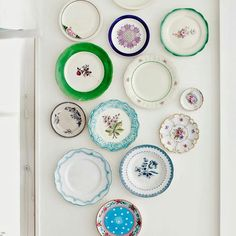 Have you ever done a plate wall? I think they are just so much fun, and I am completely charmed by this sweet and colorful example I found on Pinterest. Photography credit: Lina Ostling. #interiordesign #homedecor #homestyle #decorating #platewall #diningroom #traditionalhome #bhg #shabbychic