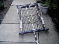Bike Trailer made of repurposed found objects. Now I know what to do with Jesses old crutches. Kayak Trailer, Bike Trailers, Bike Cart, Velo Cargo, Crutches, Camping Survival, Bike Accessories, Go Kart, Recycled Materials