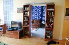 Bookcase On Hanging Door Rails (Leads to Hidden Room)