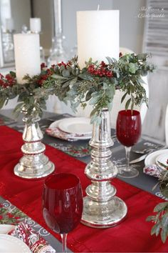 Seven Gorgeous Christmas Tablescape Ideas. Magnolia Market mini candle wreaths inspired me to do a second and more traditional table with red and green.