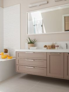 She Reversed The Doors To Give Them A More Contemporary Look - Bathroom vanity floating style