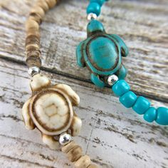 This listing is for one bracelet. Choose between turquoise turtle with blue beads OR a white stone turtle with wood beads. Each bracelet is made with seed beads and a lovely turtlebead made from dyed stone. This bracelet is stretchy. Choose from 3 sizes: Small - 7 inches Medium -