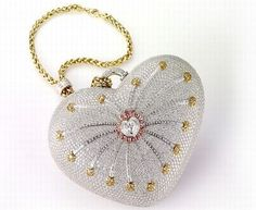 The House of Mouawad has now introduced what the Guinness World Records has labeled as the world's most expensive handbag, valued at a whopping $3.8 million. The heart-shaped purse, handcrafted from 18kt gold, incorporates 18kt gold and 4,517 diamonds (105 yellow, 56 pink and 4,356 colorless) with a total weight of 381.92 carats. Pink Handbags, Gucci Handbags, Louis Vuitton Handbags, Guinness, Lily, Burberry, 18k Gold, Yellow, Coin Purse