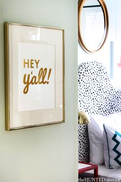 "Cute sign – ""hey y'all""… Love the shiny gold lettering"