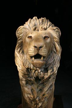 I'm thinking for the center below the top of my hand something like this would tie on perfect. A lion that looks like wood but the mane slowly will start to turn into leaves which eventually will start to make flowers and flow into my other tattoos on my arm. Perfect!
