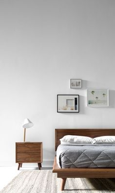 Modern Bedroom Night Stands - The white walls are accompanied by some interesting photographs attached to the wall accompanied by a large bed and wooden desk. Interior Design Minimalist, Minimalist Room, Minimalist Home Decor, Minimalist Architecture, Modern Design, Modern Bedroom Furniture, Contemporary Bedroom, Bedroom Decor, Modern Contemporary