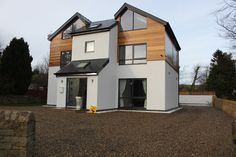 Western Red Cedar Cladding against white render on Self Build Property
