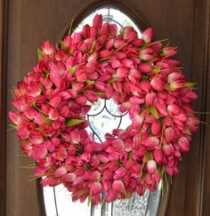 A personal favorite from my Etsy shop https://www.etsy.com/listing/228105121/hot-pinkwhite-tulip-wreath-tulip-wreath