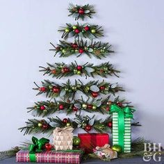 Looking for Christmas decoration for small space. Then you should definetly put up a wall Christmas Tree. Here are best DIY Wall Christmas tree ideas. Wall Christmas Tree, Office Christmas, Xmas Tree, Simple Christmas, Christmas Time, Christmas Wreaths, Christmas Ornaments, Christmas Tree Ideas For Small Spaces, Alternative To Christmas Tree